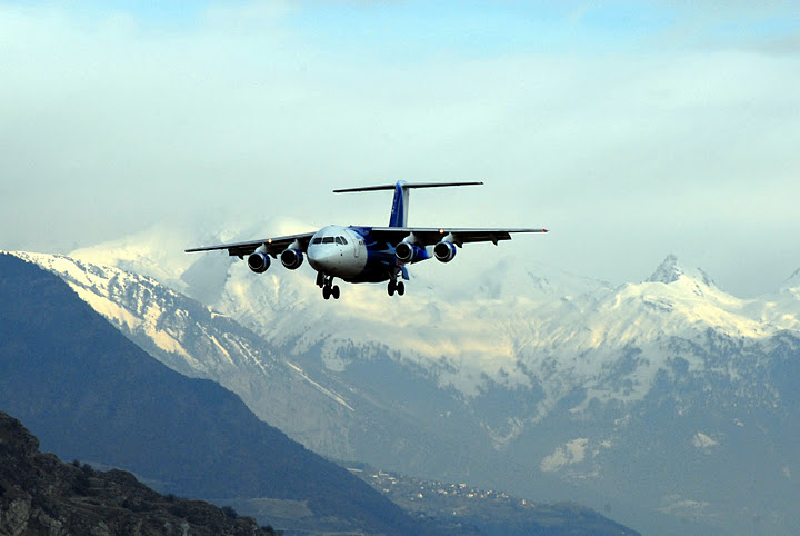 Plane landing in Sion airport Valais Swiss Alps Ski Resorts